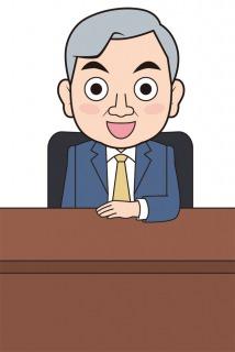 社長室で笑顔を見せる代表取締役社長
