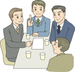 社内の会議室で打合せする男性社員